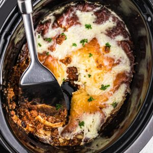 Lasagna in a crockpot ready to serve.