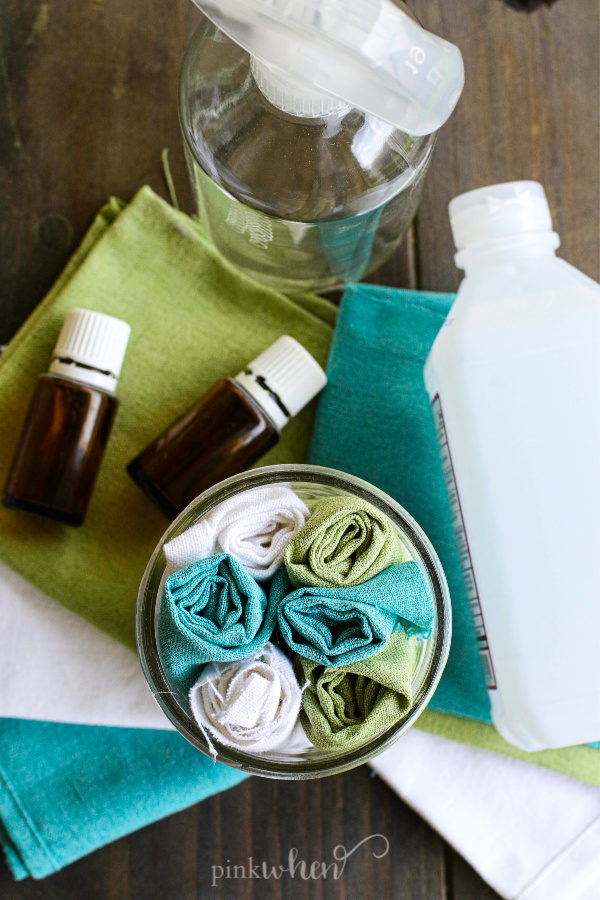 Glass jar with homemade disinfecting Wipes made from fabric pieces.