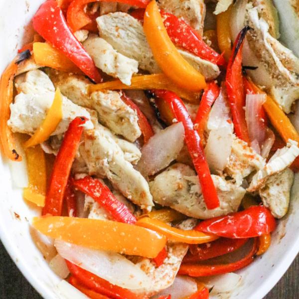 Baked chicken fajitas in a casserole dish