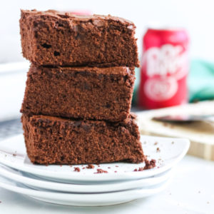Dr. Pepper Brownies stacked on a plate.