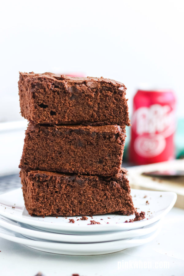 Stacked Dr. Pepper brownies ready to serve.