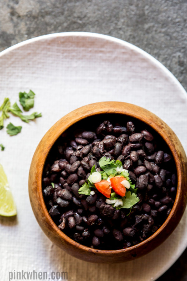 Instant Pot Black Beans in a bowl and on a plate ready to serve.