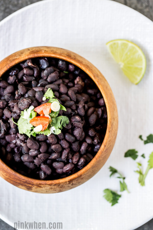 Black Beans from the Instant Pot in a bowl and on a plate ready to serve.