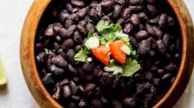 Instant Pot Black Beans in a bowl, garnished, and ready to serve.