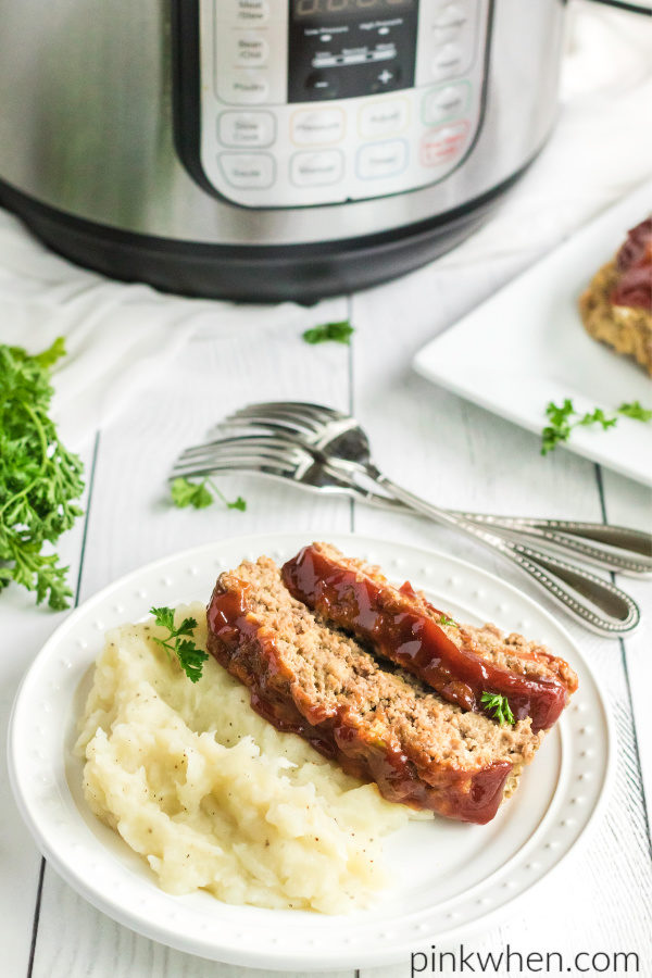 Instant Pot Meatload recipe sliced and served with mashed potatoes on a white plate.
