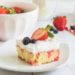 Strawberry Poke Cake on a white plate.