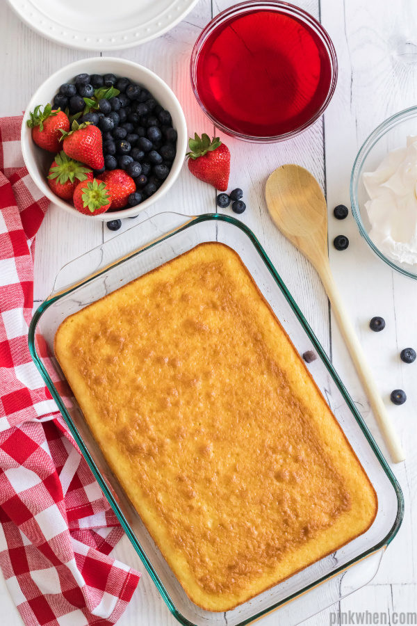 white cake mix baked and ready to be created into a poke cake.