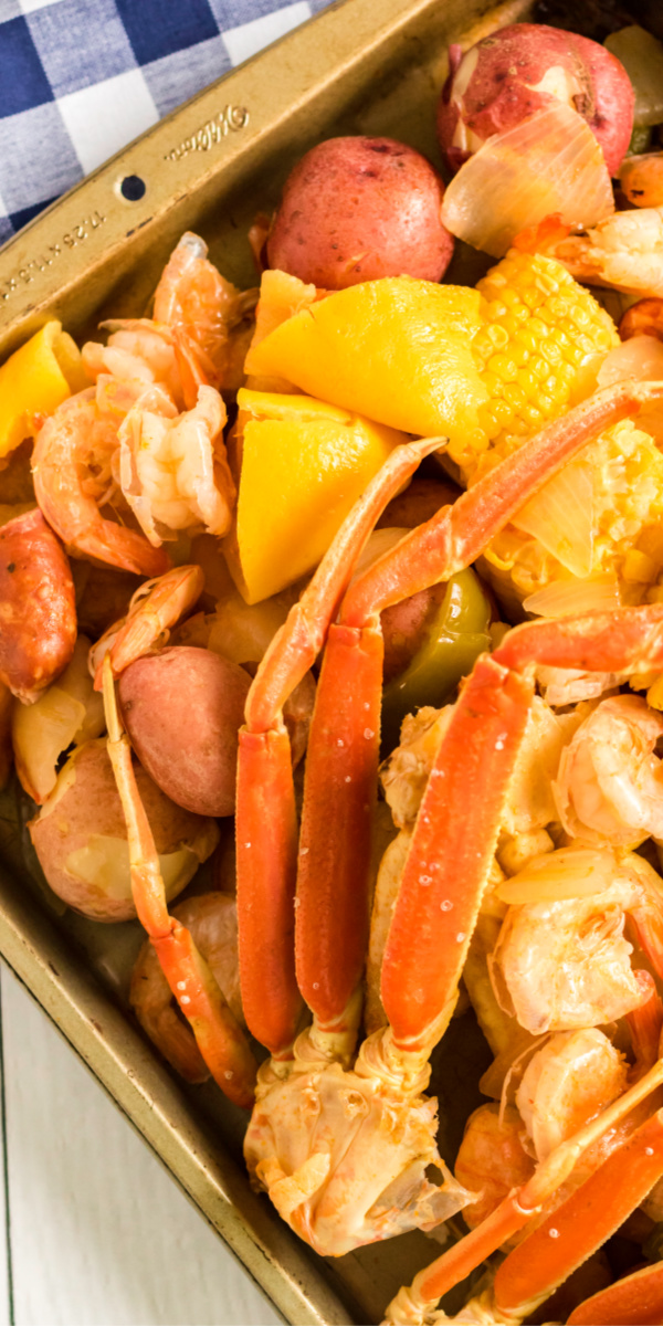 This delicious Cajun Seafood Boil is made with large shrimp, crab legs, red potatoes, fresh corn, Cajun seasoning, crisp vegetables, andouille sausage lemons, and more. It's an authentic Louisiana-style seafood boil that everyone is sure to enjoy.