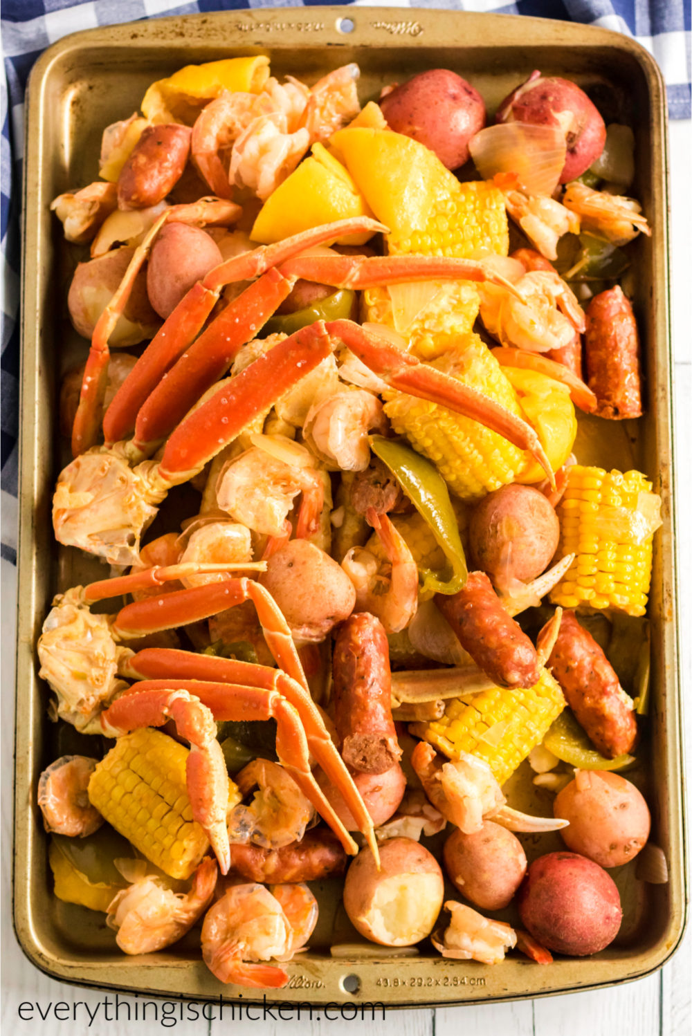 Fully seafood boil finished and served on a baking sheet and ready to eat.