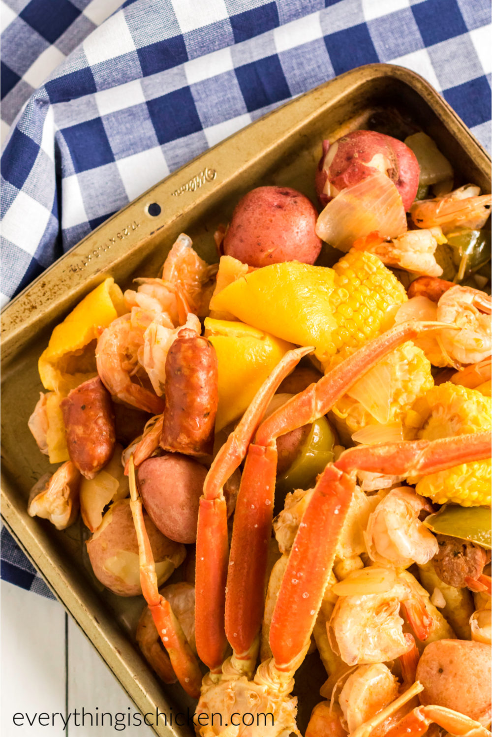 Cajun seafood boil on a checkered napkin and ready to serve.