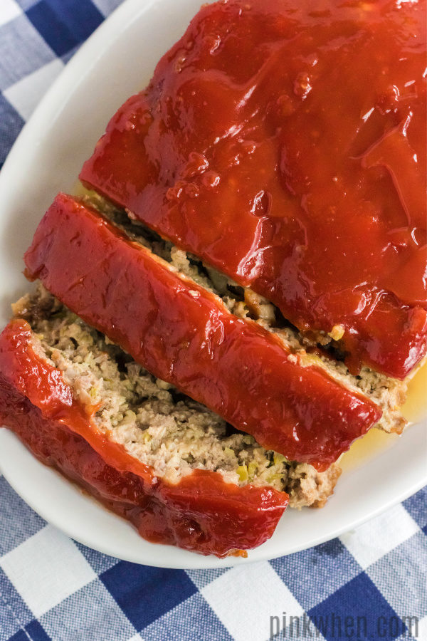 Simply the best homemade meatloaf recipe, sliced and ready to serve.