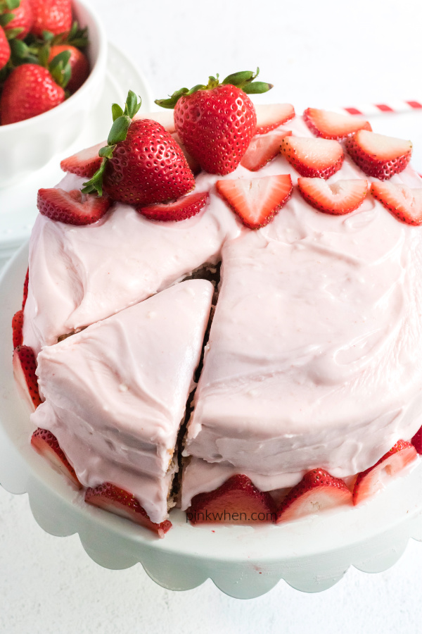 Strawberry Cake with Strawberry Cream Cheese Frosting - sliced and ready to serve.
