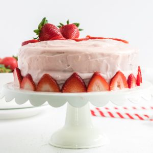 Strawberry Cake with Cream Cheese Frosting on a cake plate