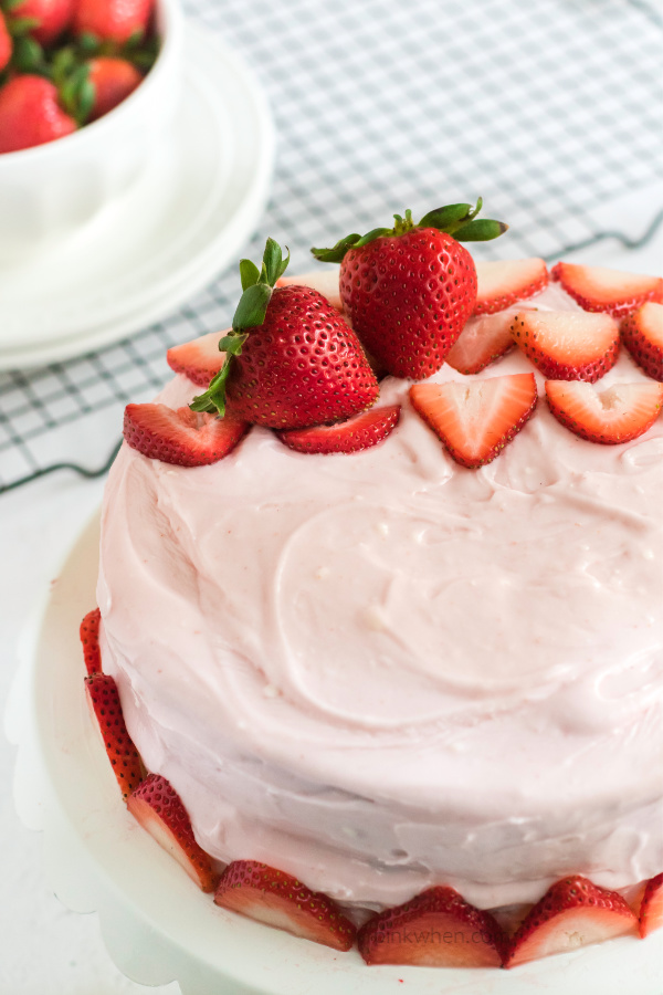 Strawberry Cake with strawberry cream cheese frosting ready to cut and eat.