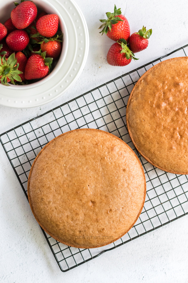 Strawberry Cake on a cooling rack.