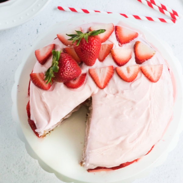 Strawberry Cake missing a piece of cake,