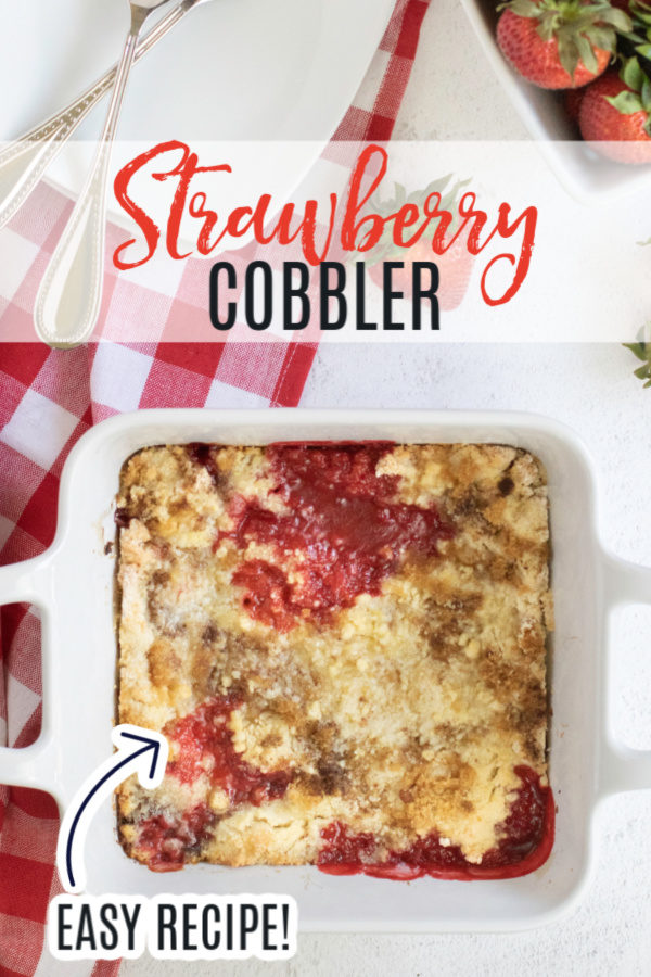 Strawberry cobbler in a square baking dish - pinnable image.