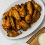 Air Fryer Chicken Wings on a white dish.
