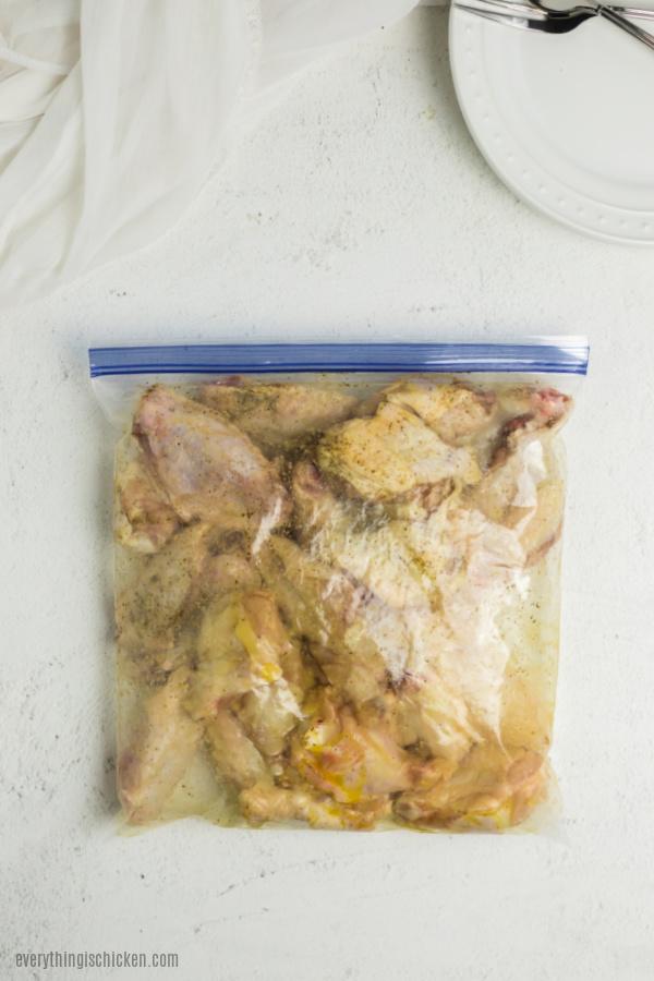 Wings getting coated in a ziplock bag