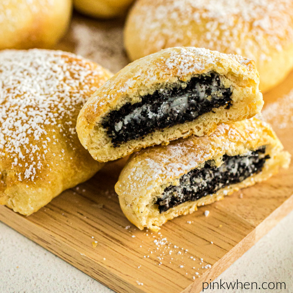 Air Fryer OREOs cut in half and sprinkled with powdered sugar.