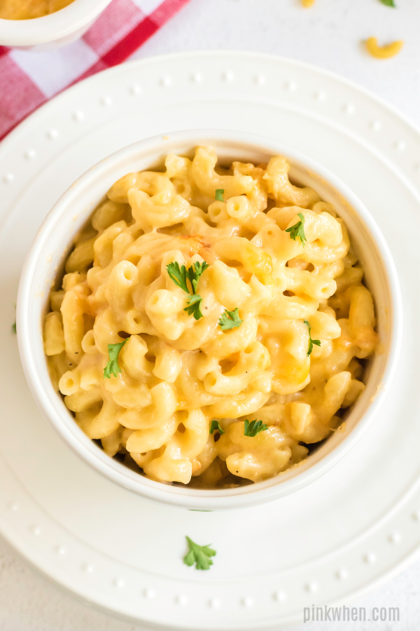 Baked Macaroni and Cheese in a bowl on a plate.