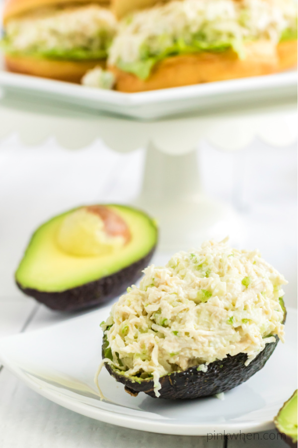 chicken salad served on an avocado.