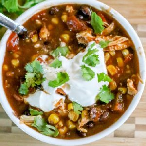 Chicken Chili garnished with sour cream and onion tops.