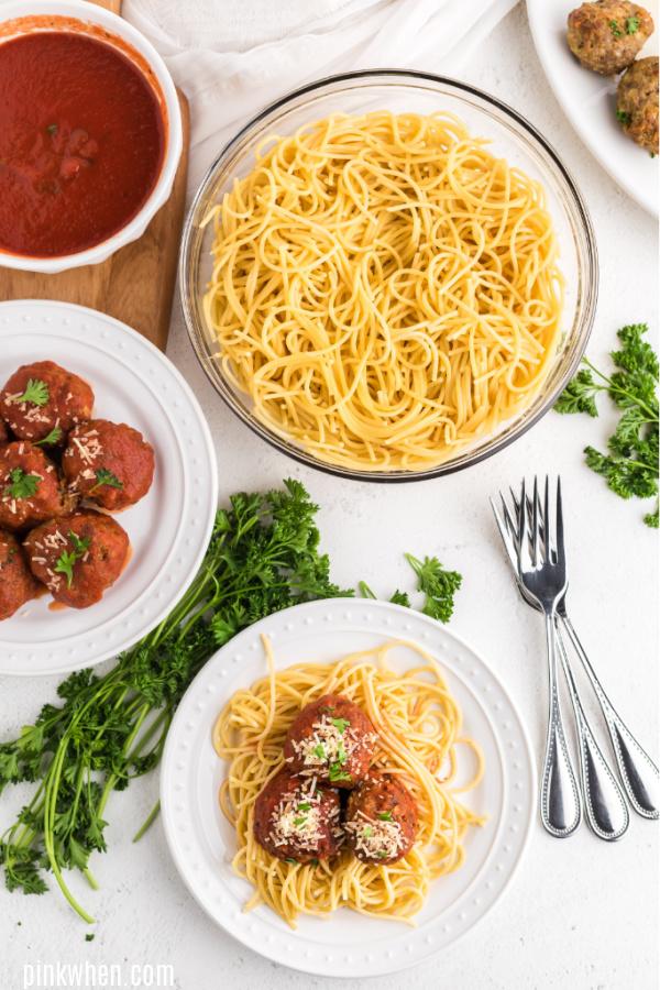 Italian Meatballs served on spaghetti with sauce.