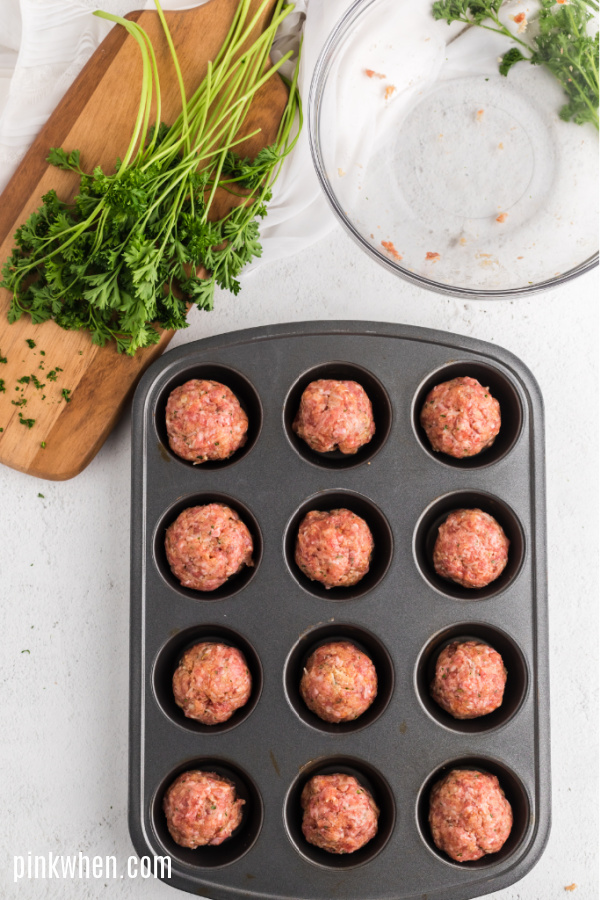 Italian meatballs packed together and in a muffin tin.