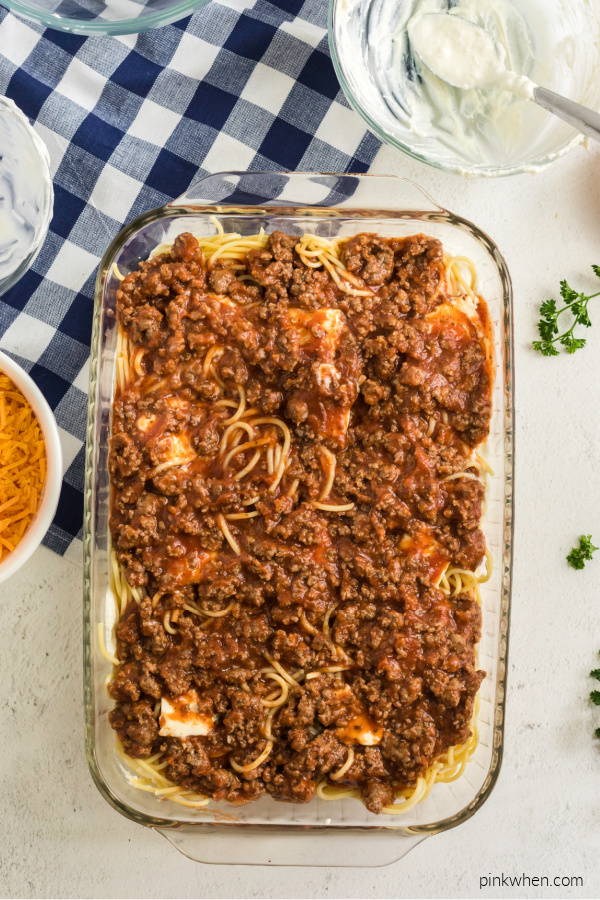 Meat sauce over layers for baked spaghetti.