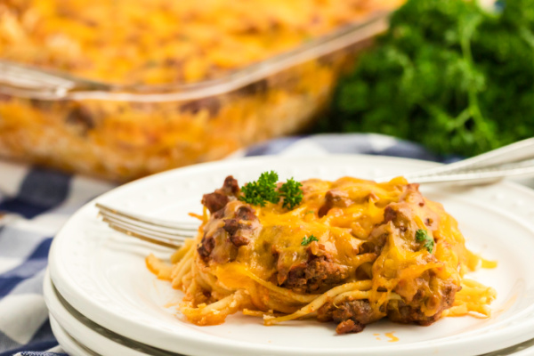 Baked spaghetti scooped onto a plate.