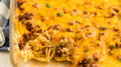 Baked spaghetti missing a slice.