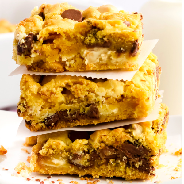 Chocolate Chip Cookie Bars stacked with parchment paper.