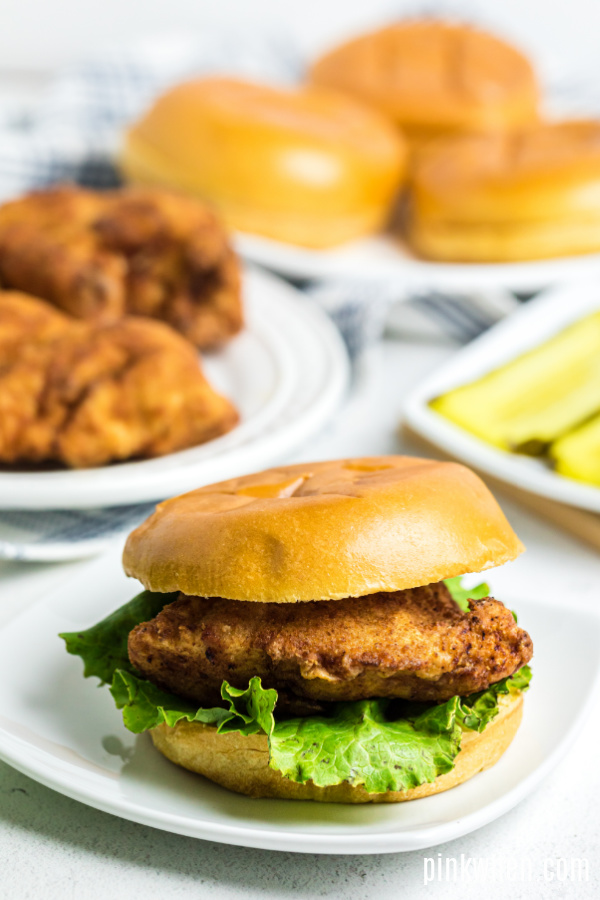 Copycat Chick FIl A Chicken Sandwich on a plate and ready to eat.