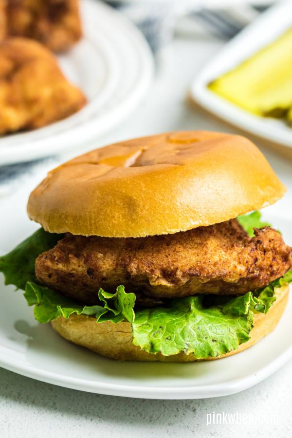 Copycat Chick Fil A sandwich on a white plate ready to serve.