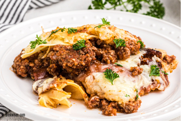 Lasagna on a white plate.