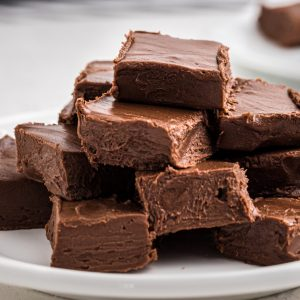 2 ingredient fudge stacked on a white plate