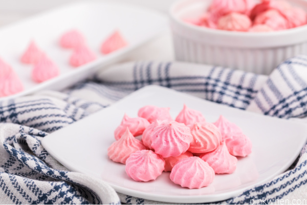 Meringue cookies on a white plate ready to eat.