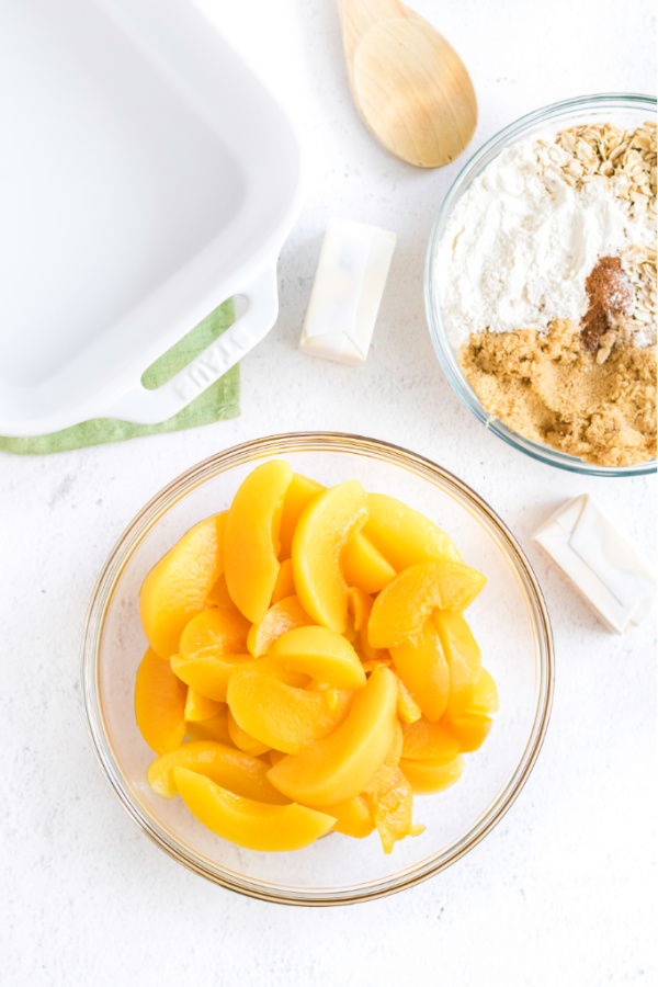 Ingredients needed to make a peach crisp.