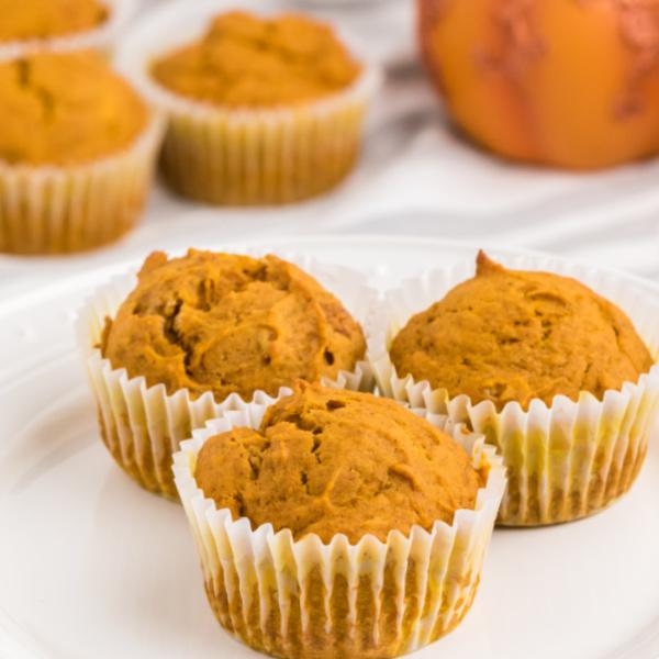 Pumpkin muffins on a white plate.
