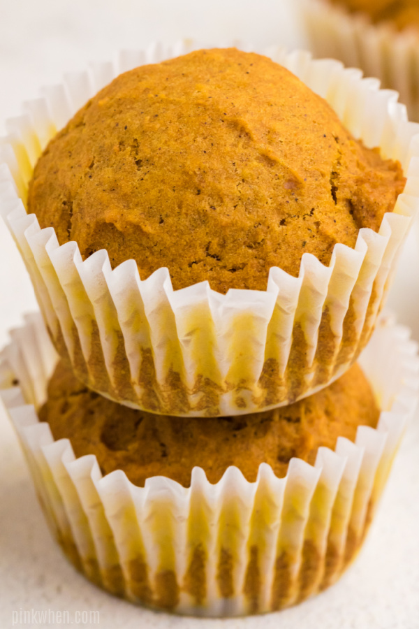 Pumpkin muffins stacked.
