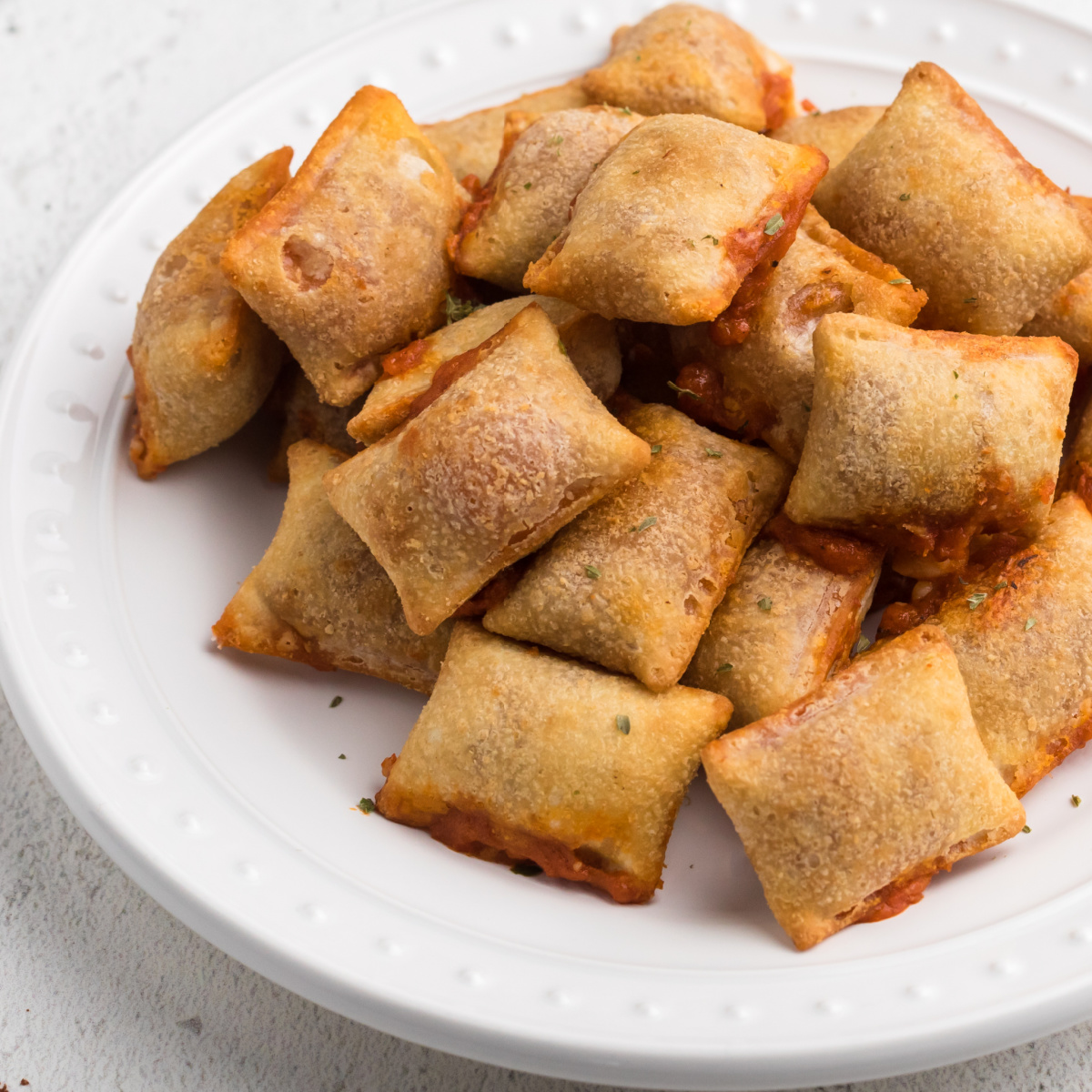 Air Fryer Pizza Rolls on a white plate.
