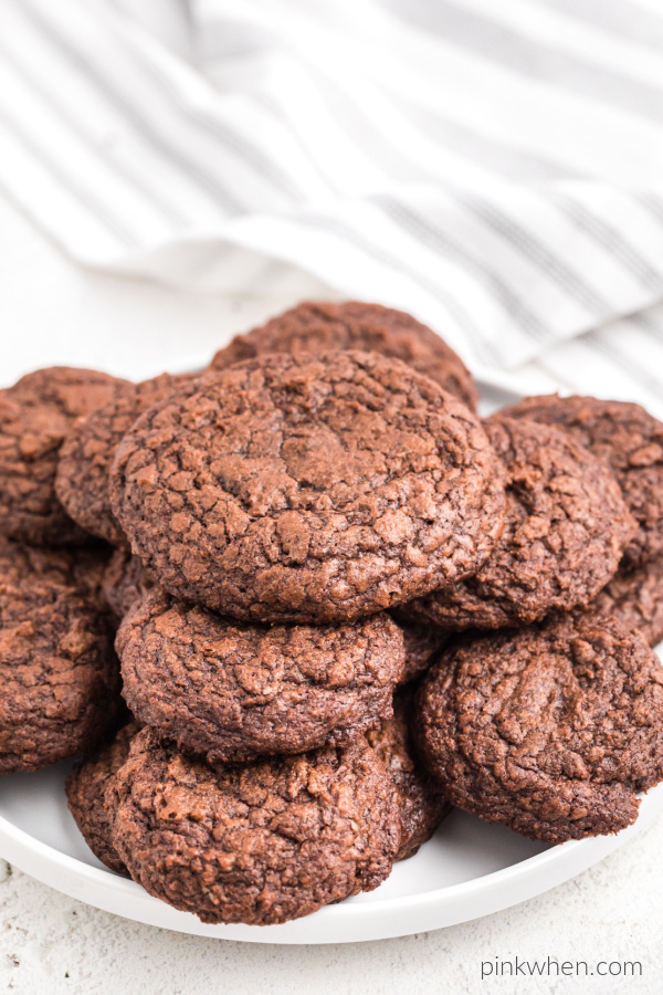 Brownie mix cookies arranged around a white plate.