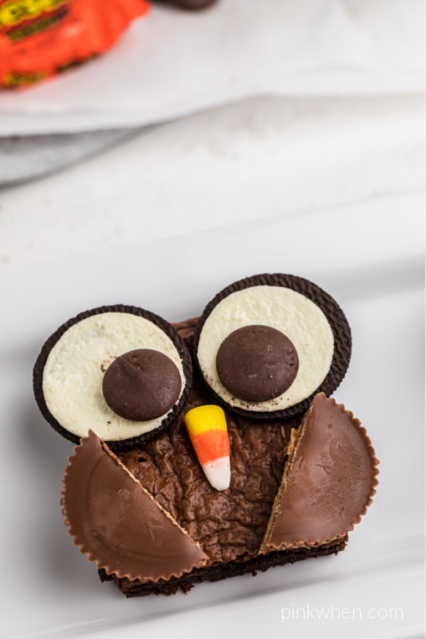 Brownie owls are made with Oreo cookies, candy corns, and Reese's cups!