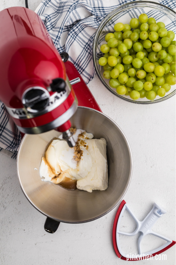 cream cheese, sugars, and vanilla in the bowl of a stand mixer.