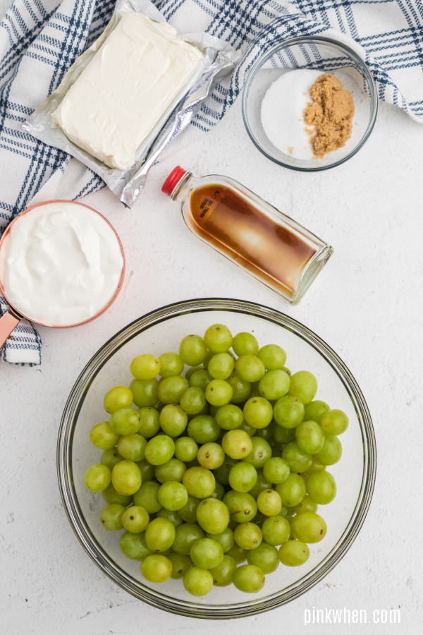 Ingredients needed for grape salad with cream cheese, sugars, vanilla, and sour cream.
