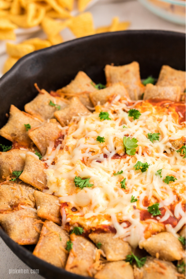 Pizza Dip and Pizza Rolls in a skillet and ready to serve.