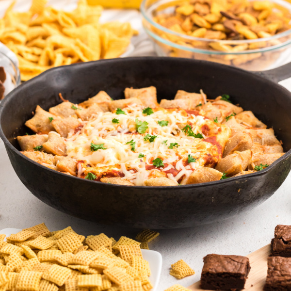 Skillet Pizza Rolls and Pizza Dip on a snack table ready to eat.