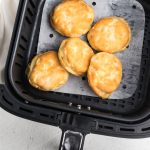 Biscuits in the Air Fryer basket after cooking.