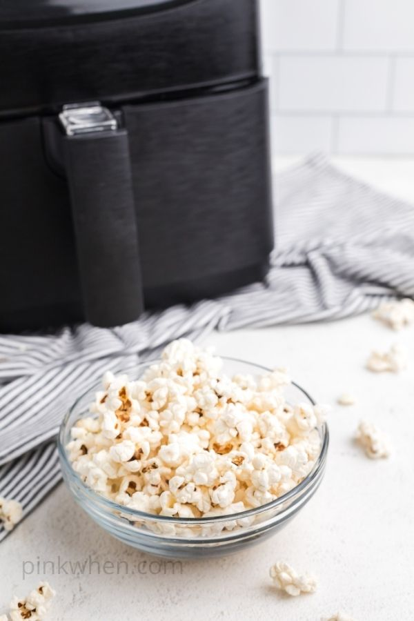 Popcorn in a clear bowl that was popped in an air fryer.